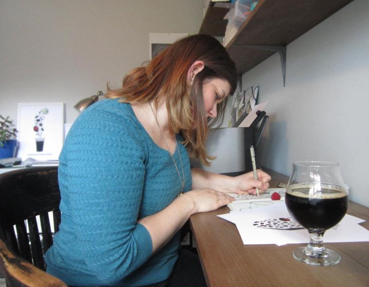 MC drawing in her home studio